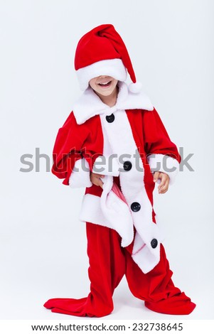 Happy santa helper trying on very large christmas costume - having fun - stock photo