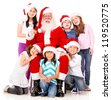 Happy Santa with a group of Christmas kids - isolated over white - stock photo