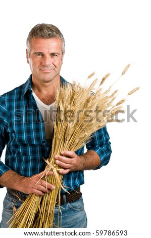 Happy satisfied mature farmer holding a bunch of wheat after the harvest isolated on white background