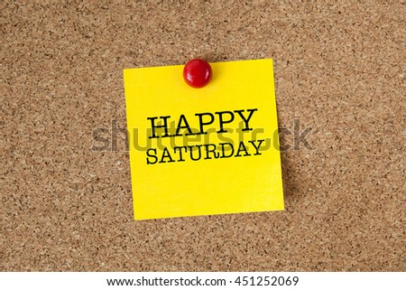 Happy saturday word with yellow reminder sticky note on cork board - stock photo