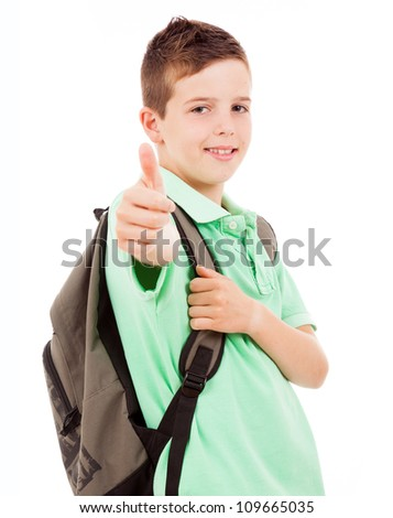 Happy school boy giving thumbs up, isolated on white background - stock photo