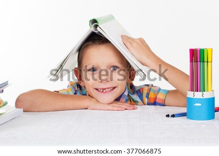 Happy school boy is tired with lessions - stock photo