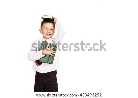 Happy School boy with books isolated on white background  - stock photo