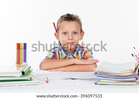 Happy school boy with pencil behind his ear - stock photo