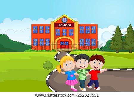 Happy school children in front of school - stock photo