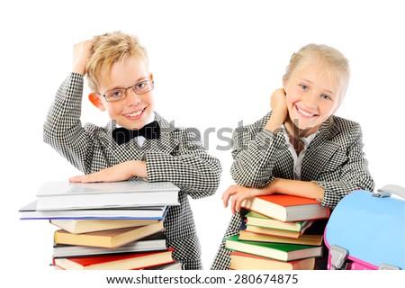 Happy school children with books - stock photo