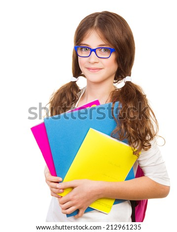 Happy school girl isolated on white background, cute brunette teenager standing and holding books, pretty school kid with cheerful smile, back to school, education and knowledge concept - stock photo