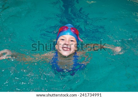 happy school girl start to swimming pool - stock photo