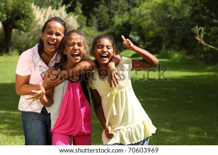 Happy school girls have fun laughing out loud with thumbs up