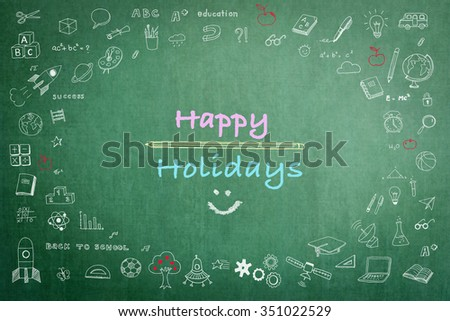 Happy school holiday concept with smiley face icon on green chalkboard & doodle freehand sketch chalk drawing background:  Greeting text message to teachers & students on seasonal break occasion   - stock photo