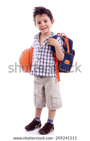 Happy school kid holding a basket ball, isolated on white background - stock photo