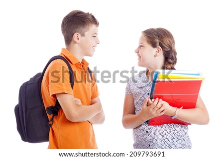 Happy school kids standing isolated on white background - stock photo