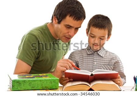 Happy schoolboy and his father learning together