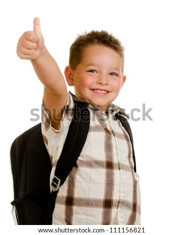 Happy schoolboy wearing backpack and giving thumbs up isolated on white