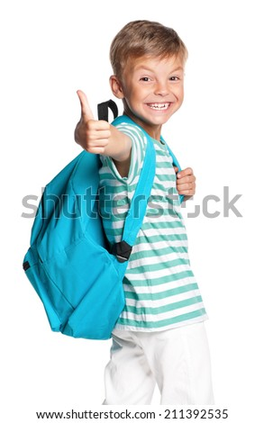 Happy schoolboy with backpack showing thumbs up sign, isolated on white background - stock photo