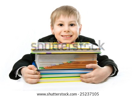 happy schoolboy with books against white background - stock photo