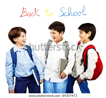 Happy schoolboys laughing, back to school, holding books and talking, isolated on white background, teenage education concept