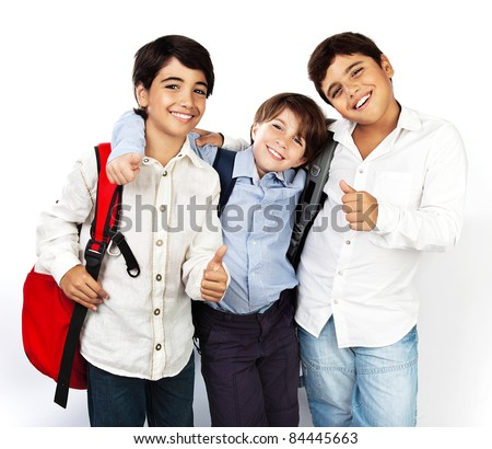 Happy schoolboys with thumbs up, back to school, boys best friends and classmates hugging, smiling, isolated on white background, teenage education concept - stock photo