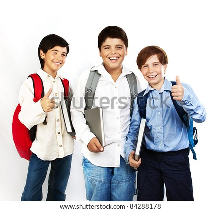 Happy schoolboys with thumbs up, back to school, boys holding books and smiling, isolated on white background, teenage education concept - stock photo