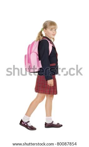 happy schoolgirl goes to school isolated on white - stock photo