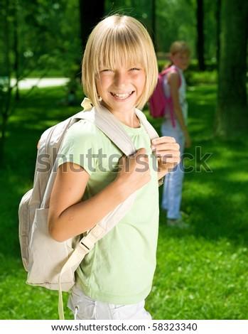 Happy Schoolgirl Outdoor.Back to School concept. - stock photo