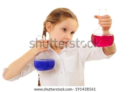 Happy schoolgirl studying chemistry - stock photo