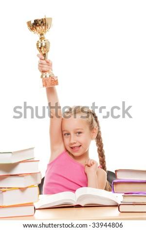 Happy schoolgirl with a golden cup - stock photo