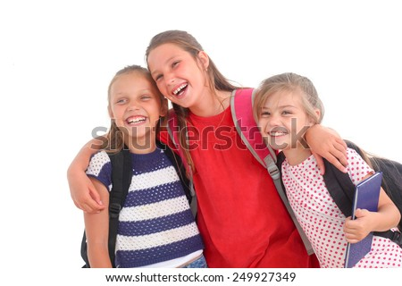 happy schoolgirls on a white background - stock photo