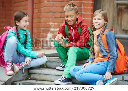 Happy schoolkids in casual enjoying time after school - stock photo