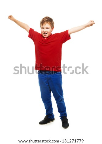 happy screaming Caucasian boy screaming and roaring with lifted hands as he just won competition - stock photo
