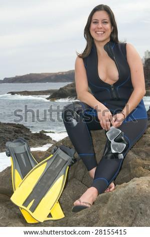 happy scuba diver woman near the sea - stock photo