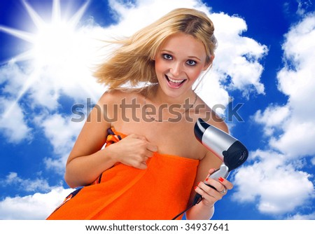 happy seductive woman blowing her hair - stock photo