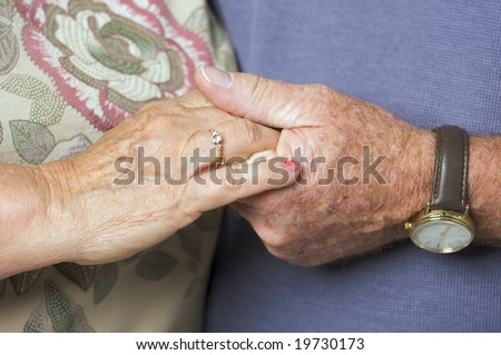 Happy Senior Adult Couple Holding Hands - stock photo