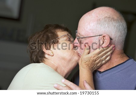 Happy Senior Adult Couple Kissing - stock photo