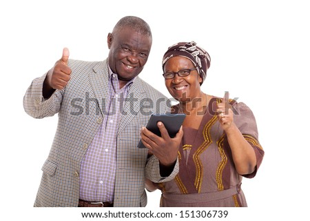 happy senior african couple with tablet pc and giving thumbs up - stock photo