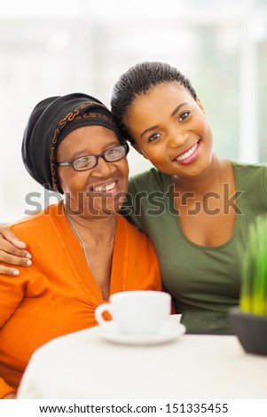 happy senior african woman with daughter at home - stock photo