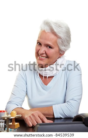 Happy senior business woman sitting at her desk - stock photo