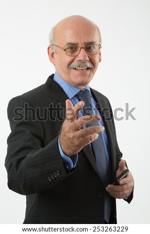 happy senior businessman talking and pointing at you