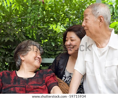 happy senior couple and their daughter - stock photo