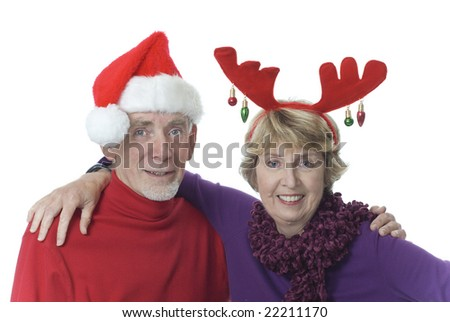 Happy senior couple dressed up for a party - stock photo