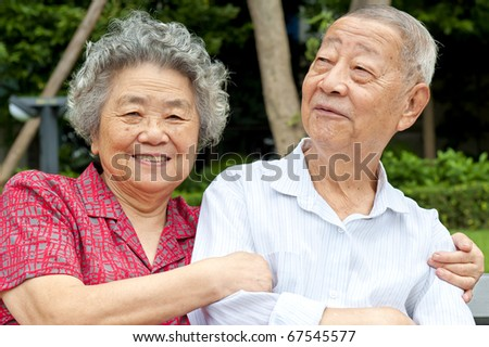 happy senior couple embraced - stock photo