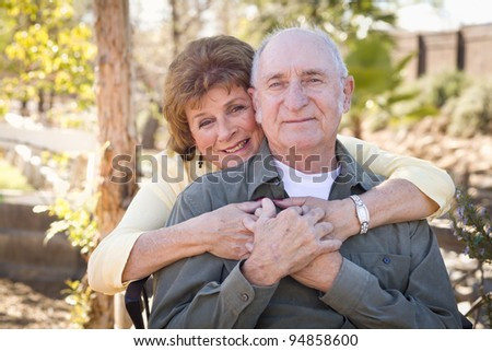 Happy Senior Couple Enjoying Each Other in The Park. - stock photo