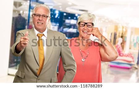 Happy Senior Couple Gesturing, Indoor - stock photo