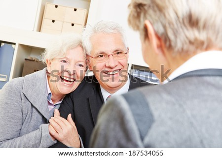 Happy senior couple getting legal consultation at lawyer - stock photo