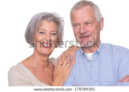 Happy senior couple in front of white background - stock photo