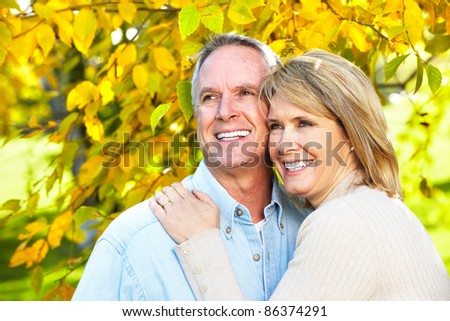 Happy senior couple in love at the park. - stock photo