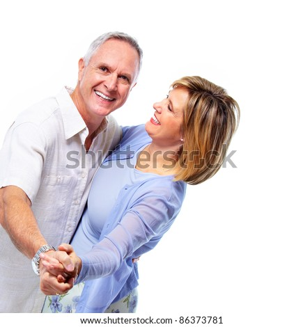 Happy senior couple in love dancing. Isolated over white background.