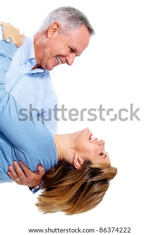 Happy senior couple in love dancing. Isolated over white background. - stock photo