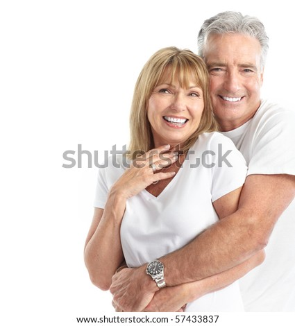 Happy senior couple in love. Healthy teeth. Isolated over white background