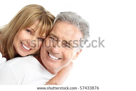 Happy senior couple in love. Healthy teeth. Isolated over white background - stock photo